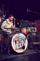 A rocket to the moon sponsored by Triple Fat Goose