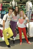 Actress Emilia Schüle (center) at Adidas Neo Hamburg with store staff