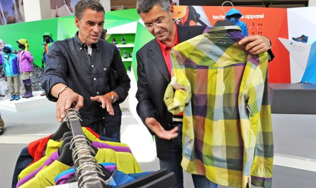 Adidas booth with CEO Herbert Hainer (left)