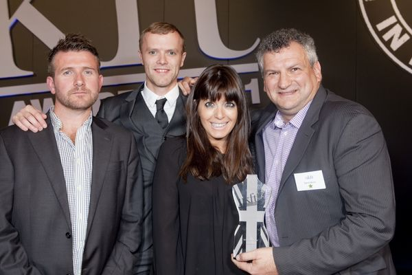 Boxfresh's Mark Underwood, Chris Walton and Daniel Morris receive the trophy from presenter Claudia Winkleman