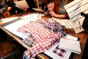 On the 2nd floor, customers may customize their own tartan shirts.