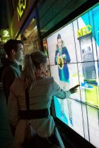 Shoppers try out the new shop window touch screen