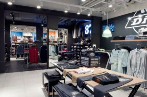 The design concept divides the store into three distinct zones for men's, women's and a core denim sector.