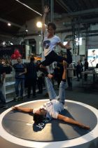 Acrobatic performers at the Orta booth