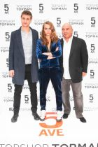 Cara Delevigne, face of the new Topshop campaign, with Max Irons and Arcadia Group chairman Sir Philip Green