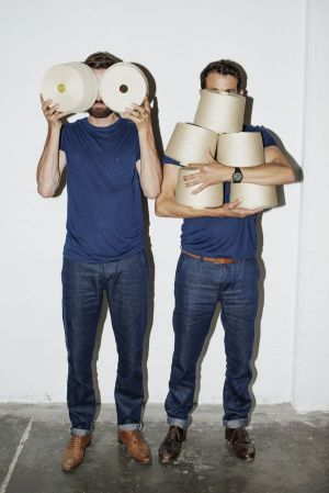 Daniel and Markus Freitag carrying Hemp yarn for Freitag's broken twill (photo: Lukas Wassmann)
