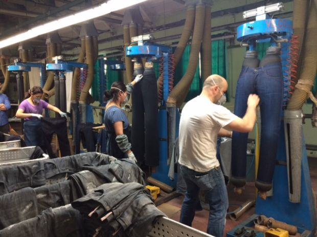 Employees treating jeans at the Calik & Martelli event