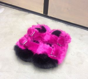 Fake fur slippers by Ainea