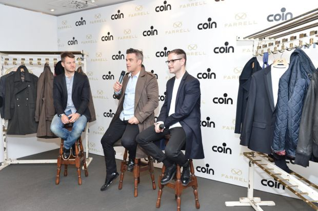 Italian TV presenter Alessandro Cattelan, Robbie Williams and Ben Dickens at the collection launch in Coin, Milan