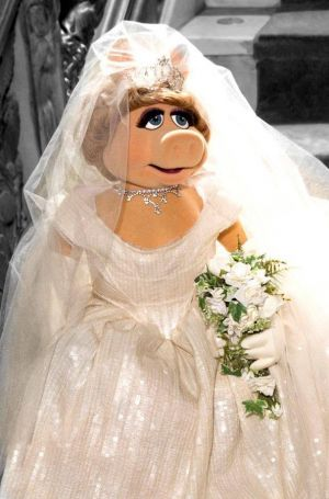 Miss Piggy wearing one of her designs