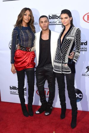 Oliver Rousteing, Balmain's creative director, and friends K. Jenner (right) and J. Dunn (left)