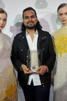 The Indian designer holding his award after the ceremony