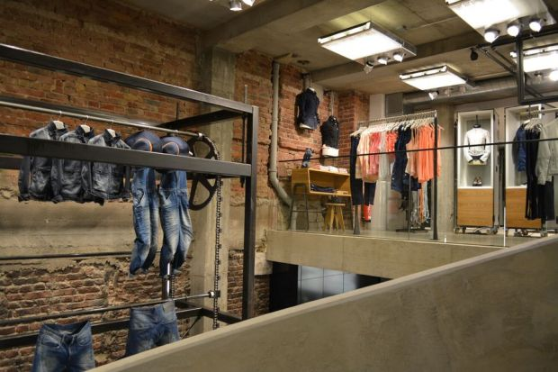 The denim wheel turns in the staircase area