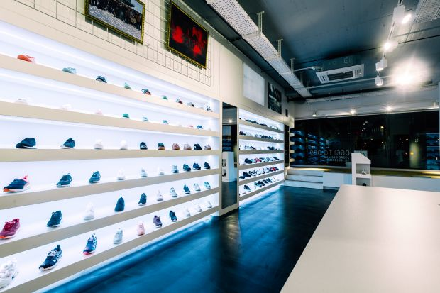 Clean white cubic structures mark the interior of the new sneaker store