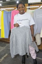 Designer Clara Martin shows proudly her creations at Liberty NY