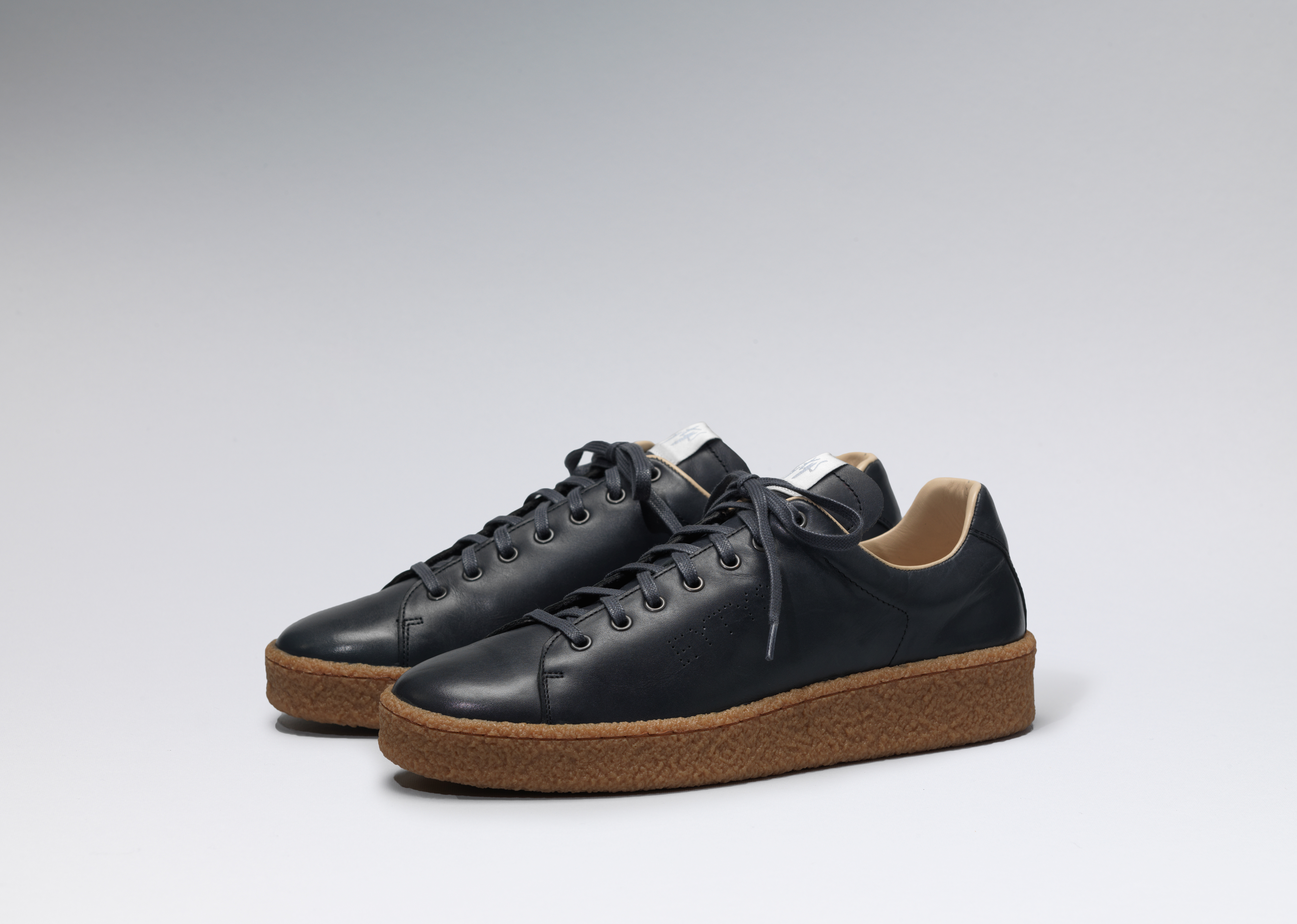 Eytys Ace in dark navy with gum soles.