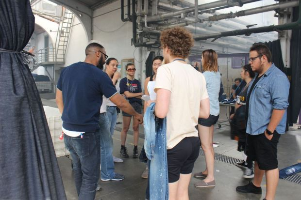 Harrell and some of his students while visiting a denim factory in Europe