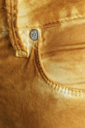 Jeans treated with Garmon's Add-Art technique