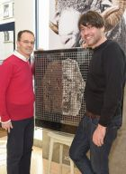 Ian Maclean, MD of John Smedley, and Alex James holding an installation of the sweater experiment, with the decomposed wool garment on the left.