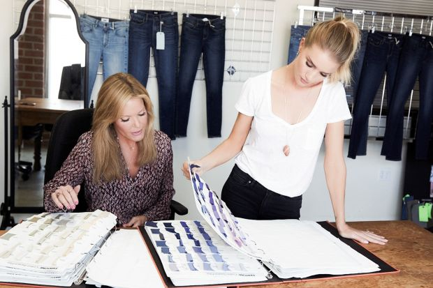 Paige Adams-Geller (right) and Rosie Huntington-Whiteley discussing collection details.