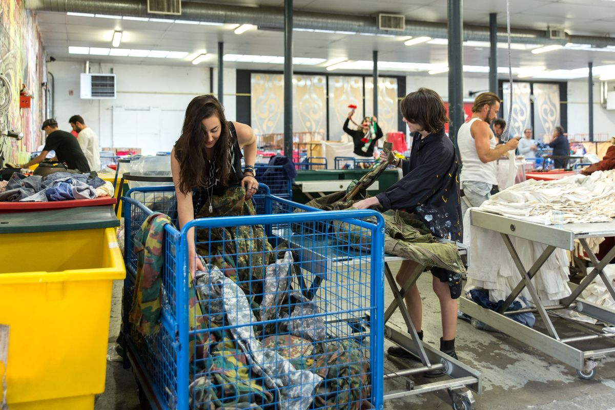 Designers searching garments at the Eureka Fripe warehouse.