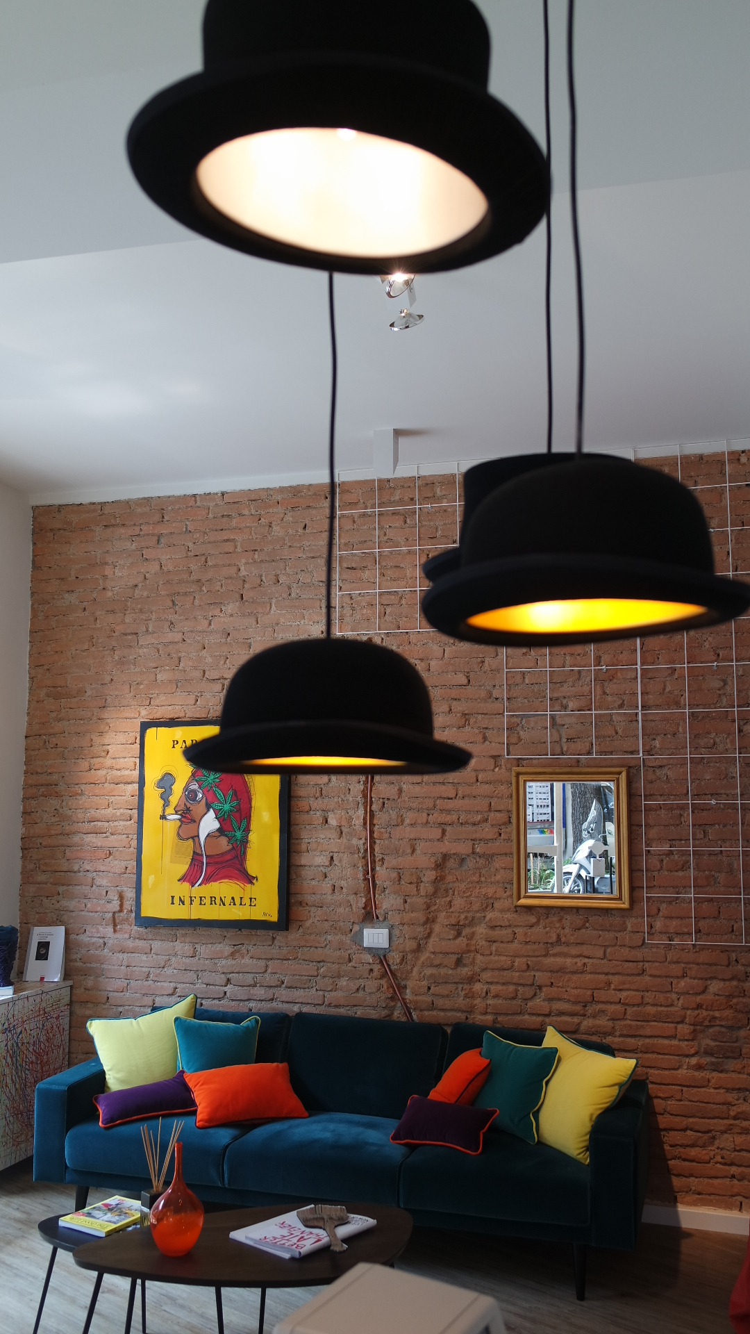 Hat lamps suspended from the ceiling at 58EttorePonti.