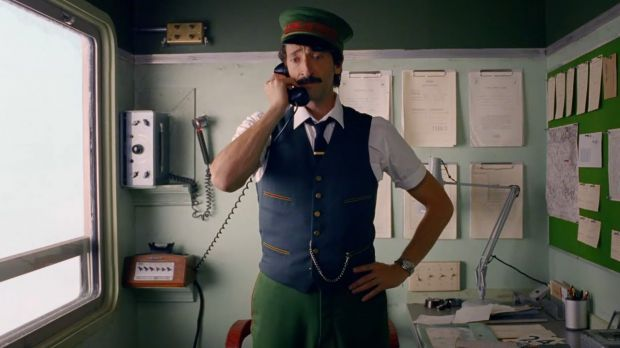 Adrien Brody as a train conductor in the new H&M commercial
