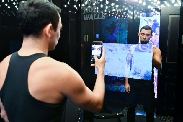 Diesel's artistic director Nicola Formichetti in one of Diesel's new interactive changing rooms