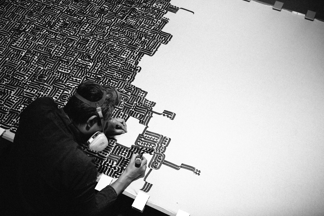 Romon Kimin Yang (aka Rostarr) working on his calligraphic artwork for Diesel.