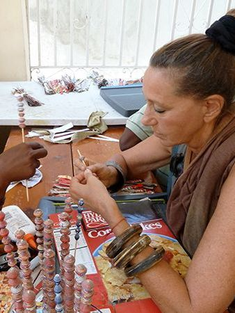Donna Karan working with a local Haitian artisan