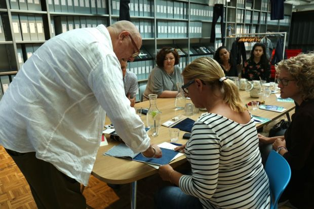 In the archive, participants learn more about denim fabrics.