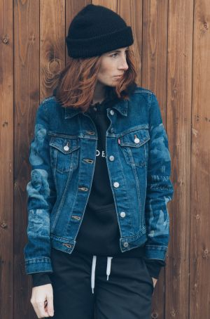 Laura Kaczmarek in her denim jacket which features cutouts from some of her recent photographs lasered onto the sleeves.