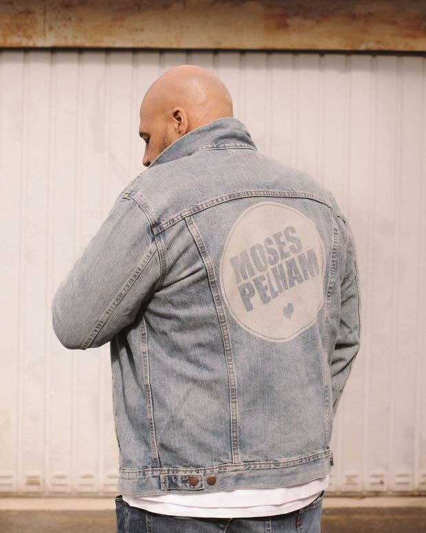 "Moses Pelham shot in Offenbach in his customized denim jacket bearing the cover image of his latest album ""Herz"""