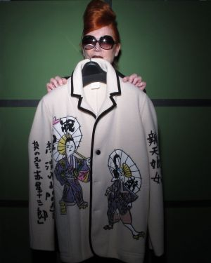 Roberta Valentini holding a vintage jacket from Kansai Yamamoto from 1975.