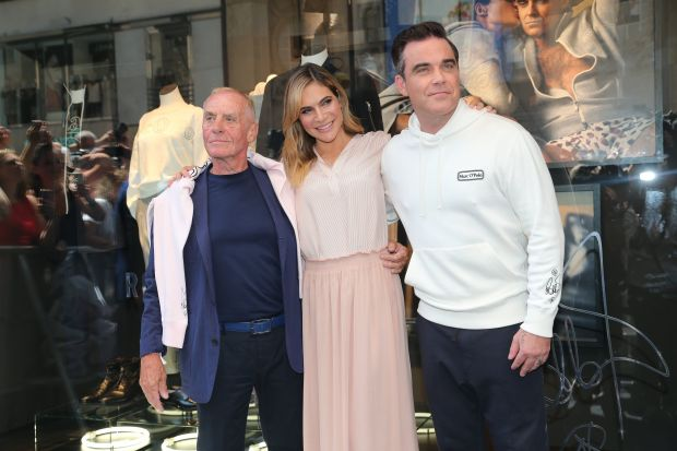 Werner Böck, owner and chairman of the supervisory board of MarcO'Polo, Robbie Williams and his wife Ayda Williams at the recent launch of Marc O'Polo's 50th anniversary sweatshirt