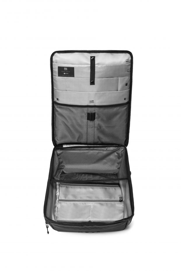 The interior features functional pockets, and spacious compartments