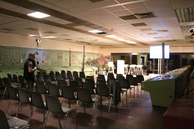 An upstairs room set up for panel discussions