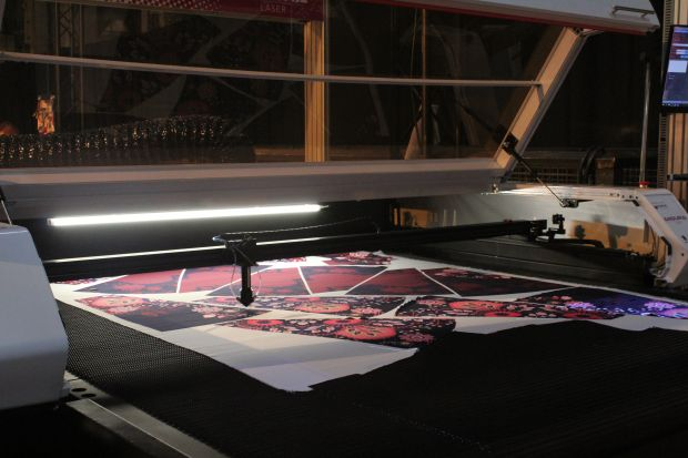 A laser machine cutting fabric for the Gemini CAD Systems micro factory.