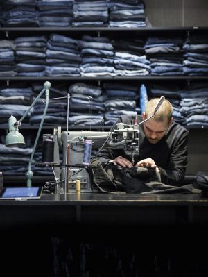 Repairing jeans at its stores is part of Nudie Jeans' DNA