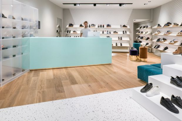 Oblique Men's flagship store in Utrecht blends classic and urban design with a shock of teal to tie it all together.