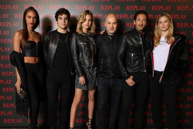 From left: Joan Smalls, lance Stroll, Meredith Mickelson, Matteo Sinigaglia (Replay), Adrien Brody, and Bar Refaeli at the Replay event