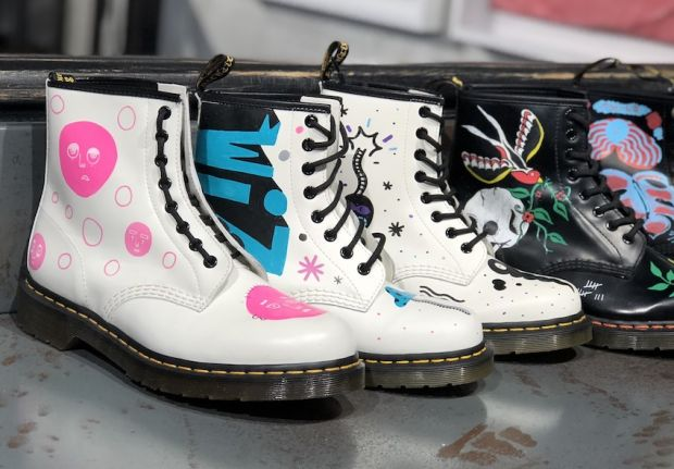 A customized parade of Dr. Martens 1460 boots.