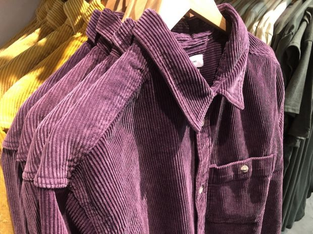 Shoppers look for corduroy shirts at Urban Outfitters