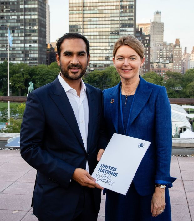 Artistic Milliners' Murtaza Ahmed with Lise Kingo, CEO/Executive Director, United Nations Global Compact