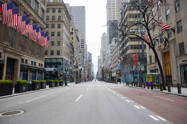 Ghost town: Manhattan's 5th Avenue with famous department store Saks Fifth Avenue (left)