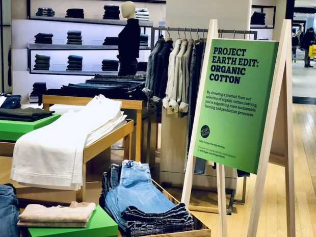 Green signs dot the store, guiding you to eco-friendly products.